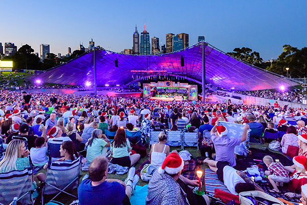 View of Carols by Candlelight audience with Sidney Myer Music Bowl in the background